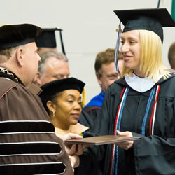 Pictured_Ellen_Kibbe_receiving_diploma_BuzzyFund